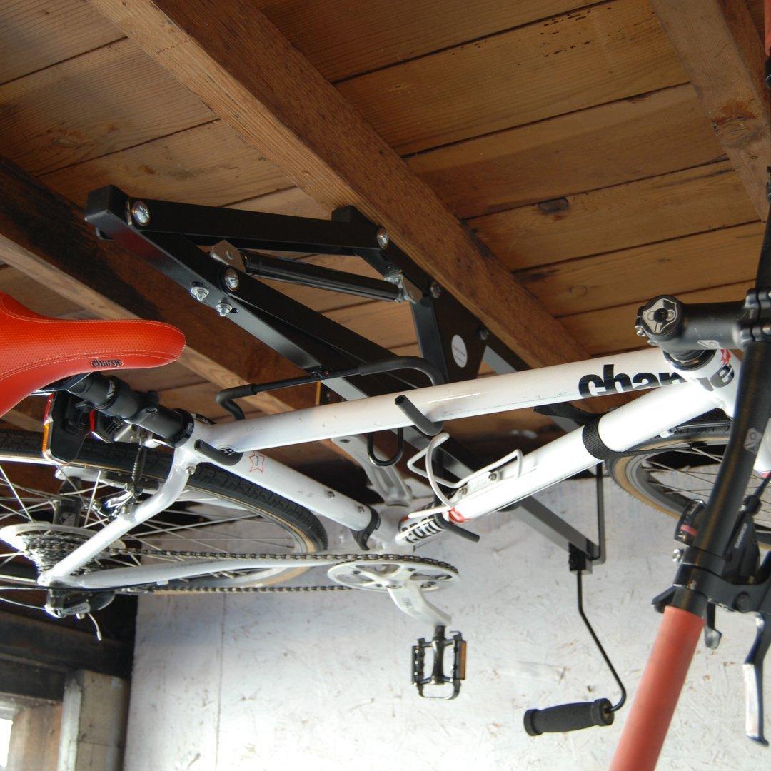 hide a ride ceiling bike rack petagadget. Black Bedroom Furniture Sets. Home Design Ideas