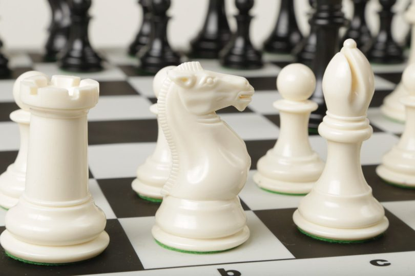 Tournament Chess Pieces And Black Silicone Board