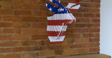 Cardboard Safari Recycled Cardboard Animal Taxidermy Deer Trophy Head, Bucky Flag Print Small