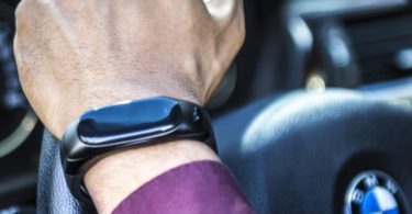 Activity Tracking Wristband with Wireless Headphones by AUPALLA