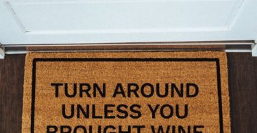 Turn Around Unless You Brought Wine Doormat