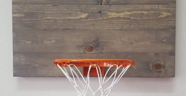 Weathered Grey Wood Basketball Hoop With Orange Rim