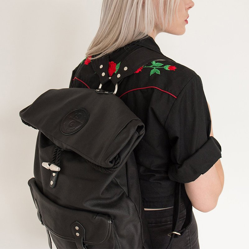 Reilly Lacquered Canvas Rolltop Backpack by Stighlorgan
