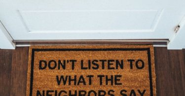 Don't Listen To The Neighbors Brown Coir Doormat