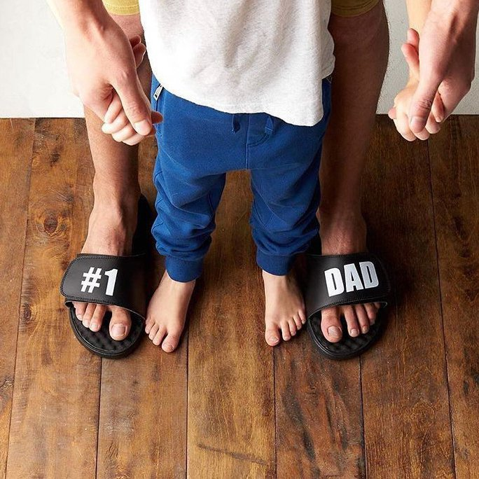 #1 Dad White Text on Black Slide Sandals