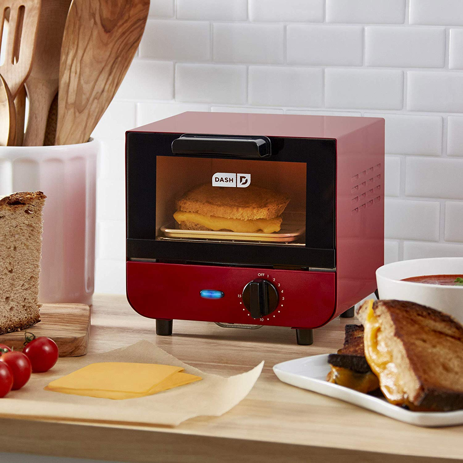 Dash DMTO100GBRD04 Mini Toaster Oven Cooker for Bread