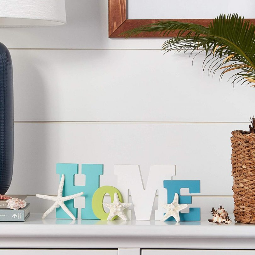 Wooden Home Word Sign with a Trio of Loose Starfish