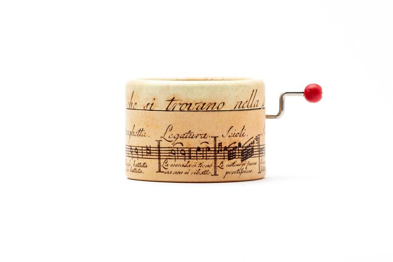 Music box decorated with old music notes