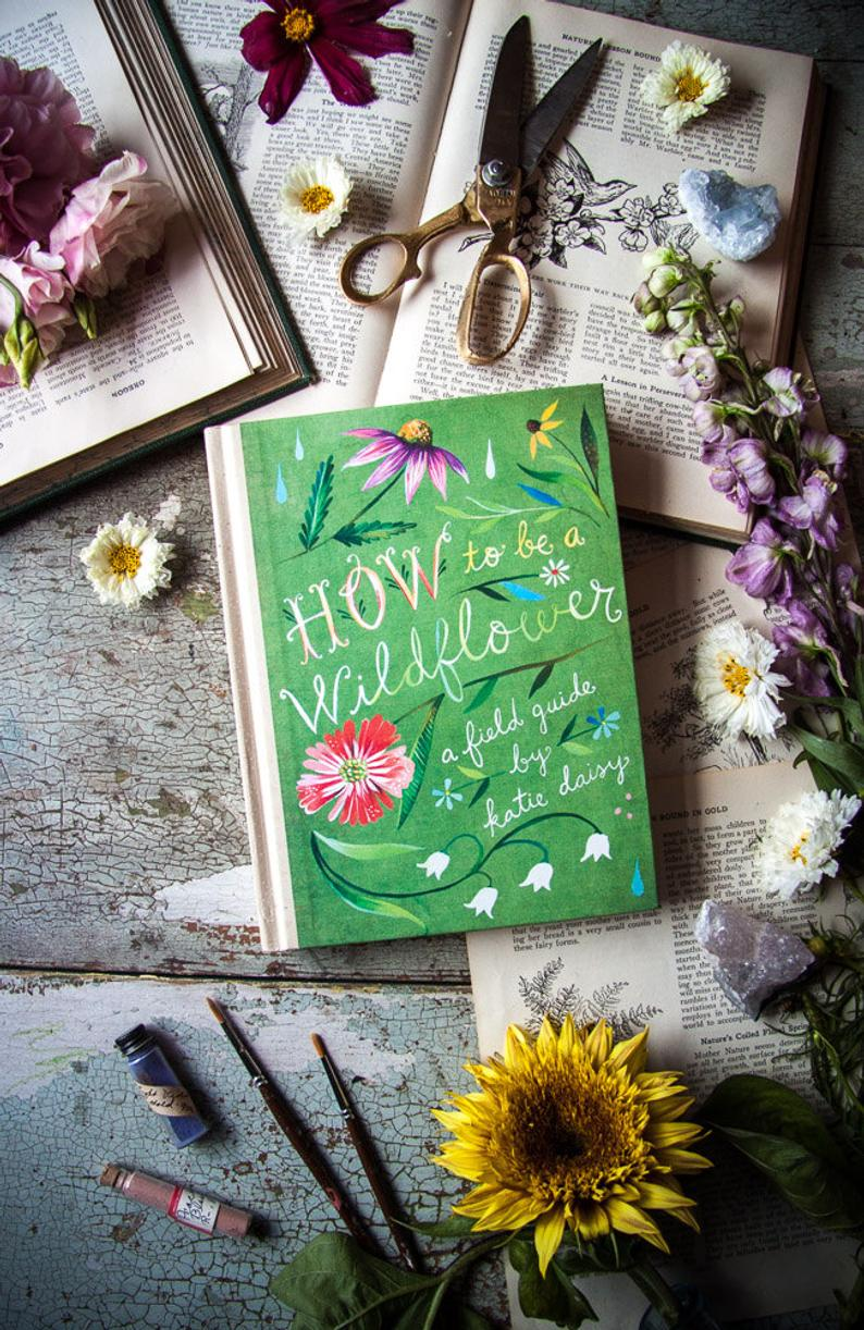 How to Be a Wildflower: A Field Guide by Katie Daisy. SIGNED