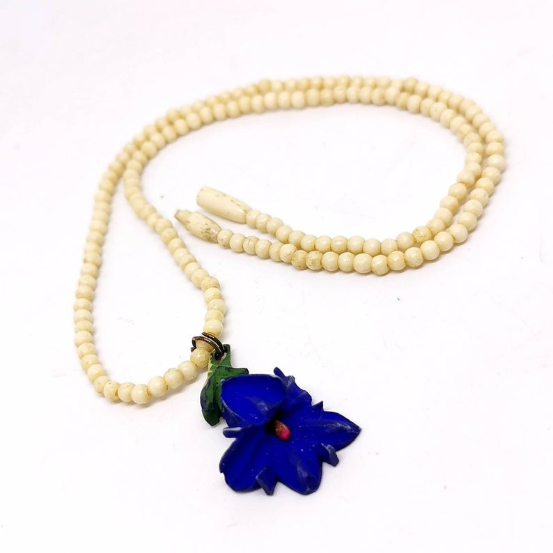 Vintage Hawaii hibiscus flower necklace. Carved bone. Vacation