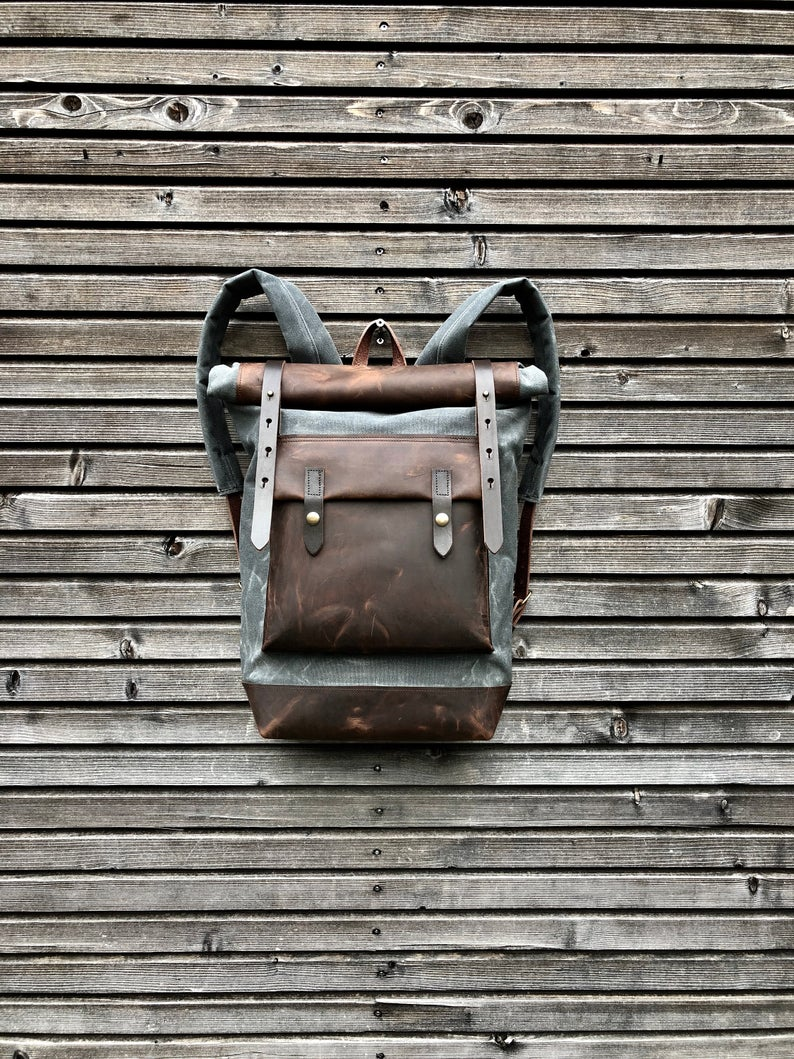 Waxed canvas backpack with roll up top and hand waxed  leather