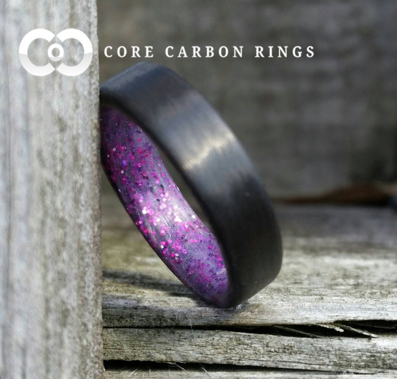 Carbon fiber unidirectional ring with purple sparkle inside