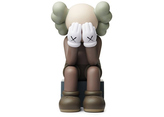 Sculpture Passing Through  Brown by KAWS