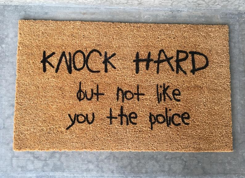 Knock hard but not like you the police welcome mat funny