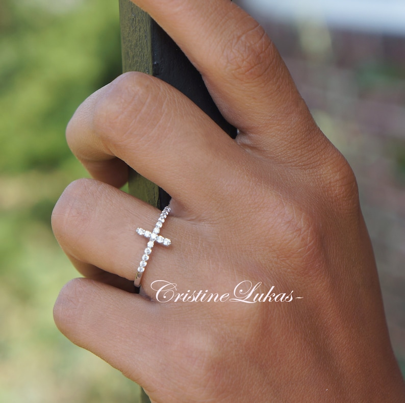 Celebrity Style Sideways Cross Ring With Clear CZ Stones